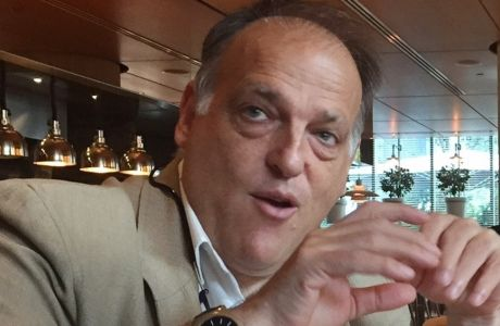 FILE - In this file photo dated  Saturday, July 29, 2017, LaLiga president Javier Tebas speaks to reporters in Miami, USA.  Tebas said in a statement to The Associated Press on Monday Sept. 4, 2017, that Abu Dhabi-funded Manchester City and Qatari-owned PSG are benefiting from state aid which distorts European competitions and is irreparably harming the football industry.(AP Photo/Gisela Salomon, FILE)