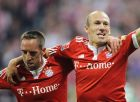 """Munich's Arjen Robben, right, celebrates his side's third goal with Franck Ribery during the German first division Bundesliga soccer match between FC Bayern Munich and VfL Wolfsburg in Munich, Germany, on Saturday, Aug. 29, 2009. (AP Photo/Daniel Maurer) """"Eds note: German spelling of munich is Muenchen"""" ** NO MOBILE USE UNTIL 2 HOURS AFTER THE MATCH, WEBSITE USERS ARE OBLIGED TO COMPLY WITH DFL-RESTRICTIONS, SEE INSTRUCTIONS FOR DETAILS **"""