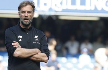 Liverpool coach Juergen Klopp awaits the start of the English Premier League soccer match between Chelsea and Liverpool at Stamford Bridge stadium in London, Sunday, May 6, 2018. (AP Photo/Frank Augstein)