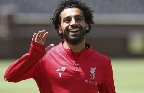 Liverpool forward Mohamed Salah waves to fans before a training session, Friday, July 27, 2018, in Ann Arbor, Mich. Liverpool FC will play Manchester United on Saturday in an International Champions Cup tournament soccer match. (AP Photo/Carlos Osorio)