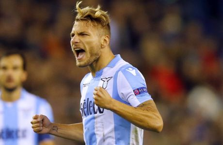 Lazio's Ciro Immobile, center, jubilates after scoring during a Europa League group K soccer match between Vitesse and Lazio at the Gelredome Arena in Arnhem, Netherlands, on Thursday, Sept. 14, 2017. (AP Photo/Peter Dejong)