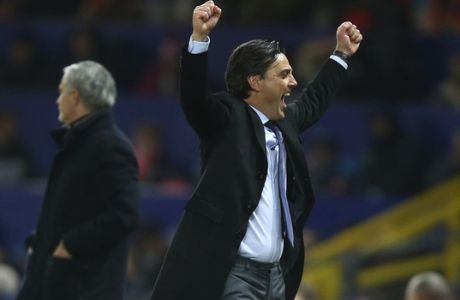 Sevilla's head coach Vicenzo Montella celebrates after his sides scored their second goal of the game during the Champions League round of 16 second leg soccer match between Manchester United and Sevilla, at Old Trafford in Manchester, England, Tuesday, March 13, 2018. (AP Photo/Dave Thompson)