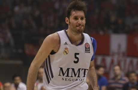 Real Madrid's Rudy Fernandez reacts after scoring a three point shot against Olympiakos during a Euroleague playoff game 4 basketball match at the Peace and Friendship Arena in Athens' port of Piraeus on Wednesday, April 23, 2014. (AP Photo/Thanassis Stavrakis)
