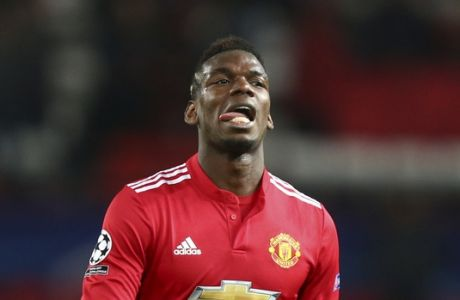 Manchester United's Paul Pogba walks off the pitch after the end of the Champions League round of 16 second leg soccer match between Manchester United and Sevilla, at Old Trafford in Manchester, England, Tuesday, March 13, 2018. Sevilla won the game 2-1 and go through to the quarterfinals .(AP Photo/Dave Thompson)