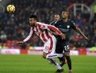 Manchester City's Fernandinho, right, and Stoke's Eric Maxim Choupo-Moting battle for the ball during the English Premier League soccer match between Stoke City and Manchester City at the Bet 365 Stadium in Stoke on Trent, England, Monday, March 12, 2018. (AP Photo/Rui Vieira)