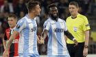 Lazio's Sergej Milinkovic-Savic, left, celebrates his side's 2nd goal with his teammate Felipe Caicedo while referee Craig Thomson from Scotland looks on during a Europa League group K soccer match between OGC Nice and Lazio at the Allianz Riviera stadium in Nice, French Riviera, Thursday, Oct. 19, 2017 (AP Photo/Claude Paris)