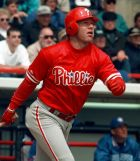 Philadelphia Phillies outfielder Lenny Dykstra watches the ball as he hits a triple in the third inning against the Toronto Blue Jays Tuesday afternoon, March. 10, 1998 in Dunedin. Dykstra, 35, is trying to make a comeback after missing the last season with back problems. (AP Photo/Pat Sullivan)