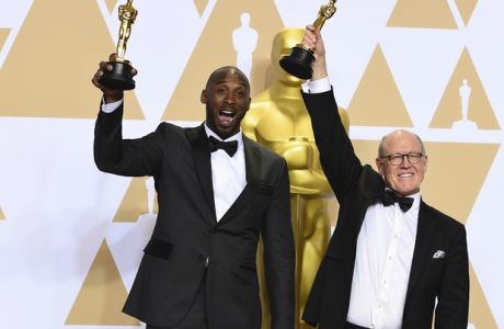 """Kobe Bryant, left, and Glen Keane, winner of the award for best animated short for """"Dear Basketball"""", pose in the press room at the Oscars on Sunday, March 4, 2018, at the Dolby Theatre in Los Angeles. (Photo by Jordan Strauss/Invision/AP)"""