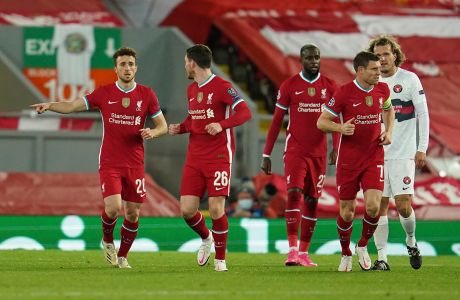 Liverpool's Diogo Jota, left, celebrates scoring his side's first goal during the Champions League Group D soccer match between Liverpool and FC Midtjylland at Anfield stadium, in Liverpool, England, Tuesday, Oct. 27, 2020. (Jon Super/Pool via AP)