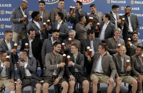 Bayern's players salut with beer in traditional Bavarian clothes during a photo shooting of a brewing company in Munich, Germany, Wednesday, Sept. 13, 2017. Mueller celebrates his 28th birthday today. (AP Photo/Matthias Schrader)