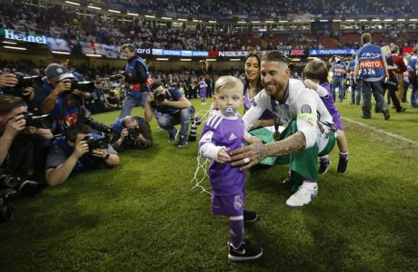 Real Madrid's Sergio Ramos celebrates with his family after the Champions League final soccer match between Juventus and Real Madrid at the Millennium stadium in Cardiff, Wales Saturday June 3, 2017. (AP Photo/Frank Augstein)
