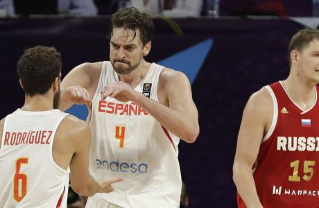 Russia's Timofey Mozgov, right, walks past as Spain's Pau Gasol, center, celebrates points with Spain's Sergio Rodriguez, left, during their Eurobasket European Basketball Championship bronze medal match in Istanbul, Sunday, Sept. 17. 2017. (AP Photo/Thanassis Stavrakis)