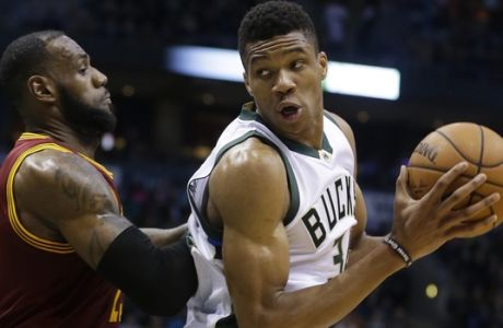 Milwaukee Bucks' Giannis Antetokounmpo is defended by Cleveland Cavaliers' LeBron James during an NBA basketball game Tuesday, Nov. 29, 2016, in Milwaukee. (AP Photo/Aaron Gash)
