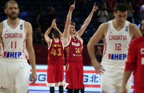 Russia's Andrey Vorontsevich, center celebrates after their Eurobasket European Basketball Championship round of 16 match against Croatia, in Istanbul, Sunday, Sept. 10. 2017. (AP Photo/Lefteris Pitarakis)