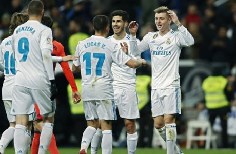 Real Madrid's Toni Kroos, right, celebrates with teammates after scoring a goal against Real Sociedad during a Spanish La Liga soccer match between Real Madrid and Real Sociedad at the Santiago Bernabeu stadium in Madrid, Saturday, Feb. 10, 2018. Kroos scored once in Real Madrid's 5-2 victory. (AP Photo/Francisco Seco)