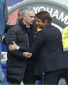 Manchester Uniteds team manager Jose Mourinho, left, and Chelseas team manager Antonio Conte meet prior to the English Premier League soccer match between Chelsea and Manchester United at Stamford Bridge stadium in London, Sunday, Oct. 23, 2016.(AP Photo/Kirsty Wigglesworth)