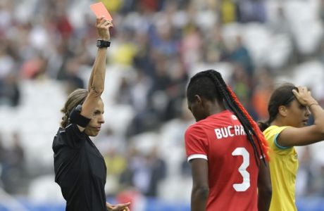 Referee Stephanie Frappart, left, gives Canada's Shelina Zadorsky, not seen in the photo, a red card during the 2016 Summer Olympics football match between Canada and Australia, at the Arena Corinthians in Sao Paulo, Brazil, Wednesday, Aug. 3, 2016. (AP Photo/Nelson Antoine)