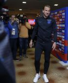 England's Harry Kane prepares to throw a dart as he takes part in a journalists challenge at the England media centre at the 2018 soccer World Cup, in Repino, near St Petersburg, Russia, Sunday, July 1, 2018. (AP Photo/Alastair Grant)