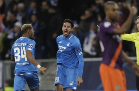 Hoffenheim forward Ishak Belfodil, center right celebrates after scoring his side's opening goal during the group F Champions League soccer match between Hoffenheim and Manchester City at the Rhein-Neckar-Arena stadium in Sinsheim, Germany, Tuesday, Oct. 2, 2018. (AP Photo/Michael Probst)