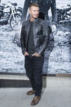 David Beckham poses at the Beckham for Belstaff collection during Fashion Week, Tuesday, Sept. 9, 2014, in New York. (AP Photo/John Minchillo)