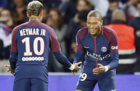 Paris Saint Germain's Kylian Mbappe, right, reacts with Neymar after he scored the second goal against Lyon during their French League One soccer match between PSG and Olympique Lyon at the Parc des Princes stadium in Paris, France, Sunday, Sept. 17, 2016. (AP Photo/Francois Mori)