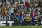 Barcelona's Lionel Messi, jumps on Jordi Alba while celebrating scoring his side's 1st goalduring a Spanish La Liga soccer match between Real Madrid and Barcelona, dubbed 'el clasico', at the Santiago Bernabeu stadium in Madrid, Spain, Sunday, April 23, 2017. (AP Photo/Daniel Ochoa de Olza)