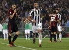 Juventus' Medhi Benatia celebrates after scoring his side's third goal during the Italian Cup final soccer match between Juventus and AC Milan, at the Rome Olympic stadium, Wednesday, May 9, 2018. (AP Photo/Gregorio Borgia)
