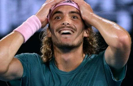 Greece's Stefanos Tsitsipas celebrates after defeating Switzerland's Roger Federer in their fourth round match at the Australian Open tennis championships in Melbourne, Australia, Sunday, Jan. 20, 2019. (AP Photo/Mark Schiefelbein)
