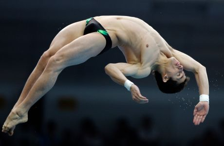 Rommel Pacheco, of Mexico, dives in the men's 10 meter platform diving semifinals during the Beijing 2008 Olympics in Beijing Saturday, Aug. 23, 2008. (AP Photo/Lynne Sladky)