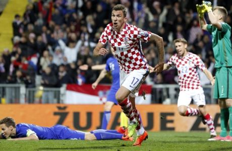 Croatia's Mario Mandzukic, center, celebrates after scoring his side's opening goal during the World Cup Group I qualifying soccer match between Croatia and Finland, at the Rujevica stadium in Rijeka, Croatia, Friday, Oct. 6, 2017. (AP Photo/Darko Bandic)