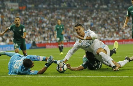 Real Madrid's Cristiano Ronaldo, right, falls down next to Betis' Antonio Adan during the Spanish La Liga soccer match between Real Madrid and Real Betis at the Santiago Bernabeu stadium in Madrid, Wednesday, Sept. 20, 2017. (AP Photo/Francisco Seco)