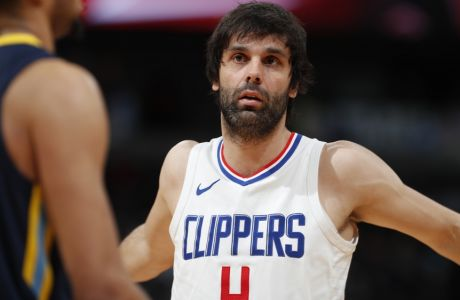 Los Angeles Clippers guard Milos Teodosic (4) in the first half of an NBA basketball game Tuesday, Feb. 27, 2018, in Denver. (AP Photo/David Zalubowski)