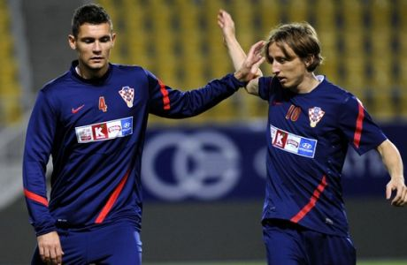 Croatia's Luka Modric, right and Dejan Lovren, left, tease each other during a training session a day before a World Cup 2014 Group A qualifying soccer match against Macedonia, Thursday, Oct. 11, 2012, in Macedonia's capital Skopje. (AP Photo/Boris Grdanoski)