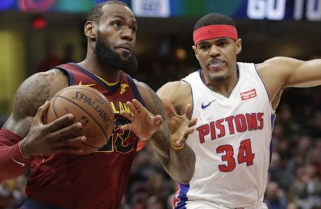 Cleveland Cavaliers' LeBron James, left, drives against Detroit Pistons' Tobias Harris in the first half of an NBA basketball game, Sunday, Jan. 28, 2018, in Cleveland. (AP Photo/Tony Dejak)