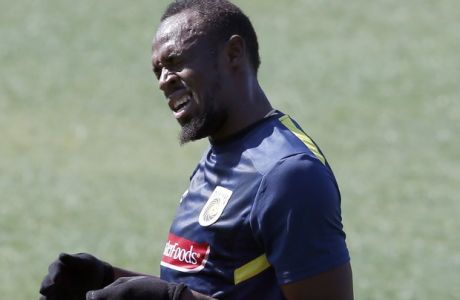 Jamaica's Usain Bolt trains with the Central Coast Mariners soccer team in Newcastle, Tuesday, Aug. 21, 2018. Bolt's attempt to win a contract to play as a professional in Australian football's A-League began in earnest on his 32nd birthday Tuesday. (AP Photo/Steve Christo)