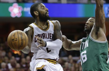 Cleveland Cavaliers' Kyrie Irving (2) passes around Boston Celtics' Marcus Smart (36) during the second half of Game 4 of the NBA basketball Eastern Conference finals, Tuesday, May 23, 2017, in Cleveland. (AP Photo/Tony Dejak)