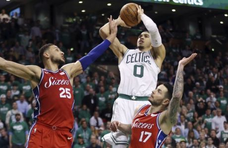 Boston Celtics forward Jayson Tatum (0) shoots against Philadelphia 76ers guard Ben Simmons (25) and guard JJ Redick (17) in the second half of Game 1 of an NBA basketball second-round playoff series, Monday, April 30, 2018, in Boston. The Celtics won 117-101. (AP Photo/Elise Amendola)