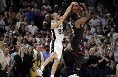 San Antonio Spurs' Manu Ginobili (20) of Argentina blocks Houston Rockets' James Harden three-point shot attempt in the final seconds of overtime of Game 5 in a second-round NBA basketball playoff series, Tuesday, May 9, 2017, in San Antonio. San Antonio won 110-107. (AP Photo/Eric Gay)