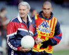 Former England soccer coach Bobby Robson of F.C. Barcelona takes a break from training Friday Jan. 10, 1997 in Barcelona. Robson dismmissed rumors Jan.10 that he is considering moving to English club Newcastle. In background is Brazilian and Barcelona striker Ronaldo.(AP Photo/Cesar Rangel)