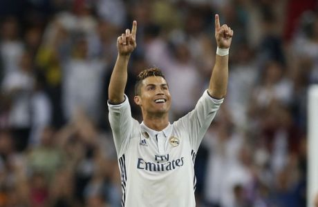 Real Madrid's Cristiano Ronaldo celebrates at the end of the match after the Champions League semifinal first leg soccer match between Real Madrid and Atletico Madrid at the Santiago Bernabeu stadium in Madrid, Spain, Tuesday, May 2, 2017. (AP Photo/Francisco Seco)